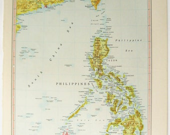 Vintage paper map of the Philippines, Formosa (Taiwan) and parts of China.  Printed  1950s.  India, Pakistan and Burma on the reverse.