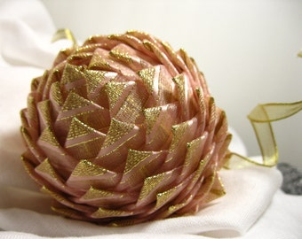 collectible pink and gold Christmas ornament,