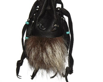 Raccoon fur claws and leather medicine bag totem