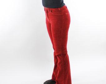 "Vintage 70's Levi's velour corduroy pants, flared leg, bootcut, rusty orange red, zipper fly - 27"" waist"