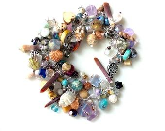 beaded bracelet. handmade multicolored beaded wire wrapped layered seashells and gemstone bracelet.
