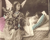 ANGEL Sitting Next to Sleeping Girl Hand Tinted Photo Postcard Circa 1905 FAIRY FAIRIE