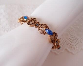 1960s Florenza antique golden filigree link bracelet with lapis blue & aurora borealis stones
