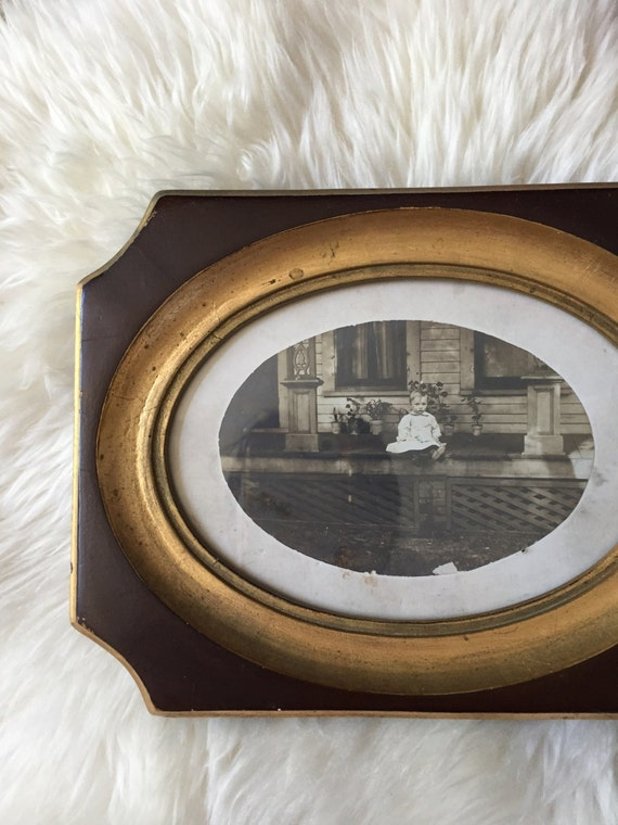 antique black and white framed photo of a baby / child