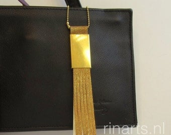 Leather bag charm / leather necklace pendant in gold goatskin with a gold tone solid brass tassel end.