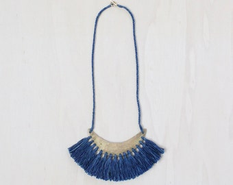 ESKER necklace | cast brass crescent with indigo dyed cotton tassel fringe and handspun cotton cord