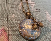 One of a kind bronze HubbleBubble charm necklace in blue, grey and tones with acorn charm