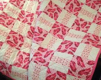 "Pinks In Couture Fashion, In This 40"" X 49"" Quilt"
