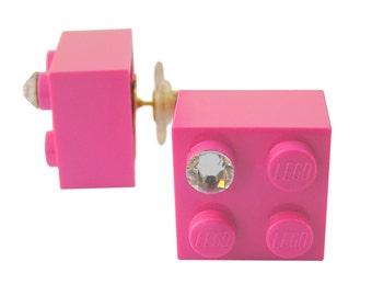 Dark Pink LEGO (R) brick 2x2 with a Diamond color SWAROVSKI crystal on a Silver/Gold plated stud