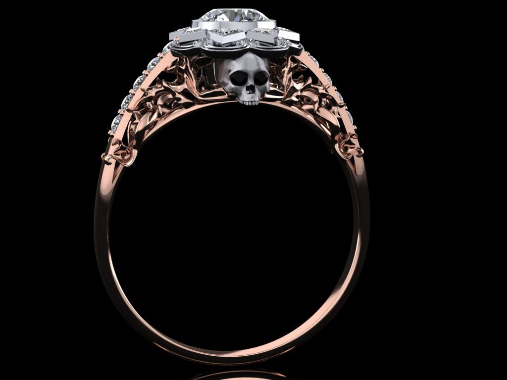 style skull engagement ring with half carat center