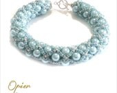 Hand Woven 6mm Grey Blue Czech Glass Pearl Bracelet with matching Toho seed beads, silver accent beads, and silver Plated Toggle Clasp