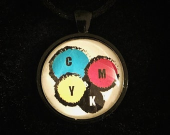 Bookish necklace: Graphic design. CMYK colours - cyan, magenta, yellow, key.