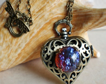 Heart watch locket with dragons breath glass opal on front cover.