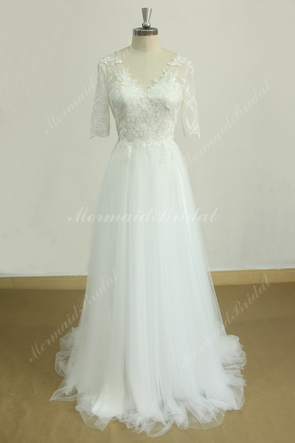 Flowy a line tulle lace beach wedding dress with middle calf for Flowy wedding dress with sleeves