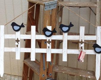 Coat rack/ Birds on a fence