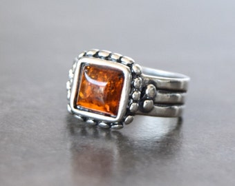 Sterling silver ring with Baltic amber for women