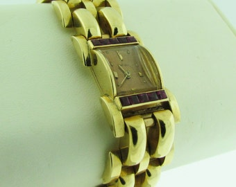 Vintage Concord solid 14 K gold and Ruby quartz watch