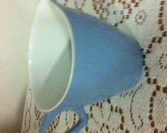 small blue and white vintage melamine jug