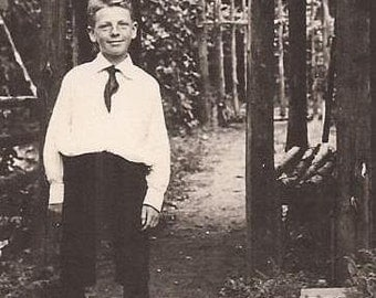 Dapper Young Man Standing Near a Vine Covered Trellis, Vintage Photograph, Black and White Photo, Well Dressed Boy with Neck Tie in Garden