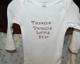 New Baby Onezie,  Color--White with multi color thread for the embroidery Size 9 months,  Long Sleeves ,