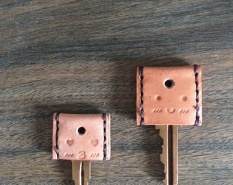 Personalized leather key covers / key toppers with initials and / or emoticons