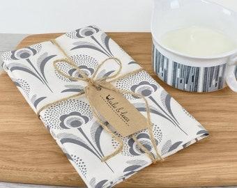 Printed tea towel with Art Deco dandelion print