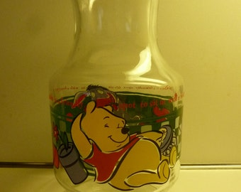"""Colorful Anchor Hocking Winnie The Pooh 56 ounce Decanter """"A garden is a friendly spot to sit in with a honey pot"""""""