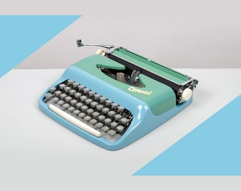 1965 Consul Typewriter. Excellent condition and fully working. Model 232. Czech. Baby blue and Sea foam green. With Case.