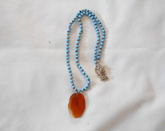 Turquoise Beaded Necklace with Amber Colored Pendant. (220)