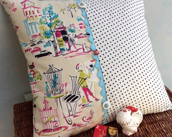 Square pillow with Parisian flair and cute polka dot pattern with vintage buttons