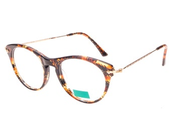 Stunning Kenzo Paris new old stock cat eye spectacle frames in adorned golden metal and cello, 2 colours