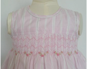 Gorgeous hand smocked dress in baby pink with hand smocking and embroidery
