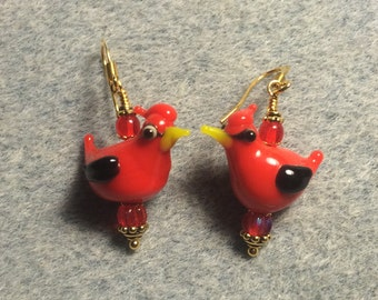 Red lampwork cardinal dangle earrings adorned with red Czech glass beads.
