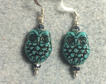 Turquoise with black wash Czech glass owl bead earrings adorned with black Chinese crystal beads.