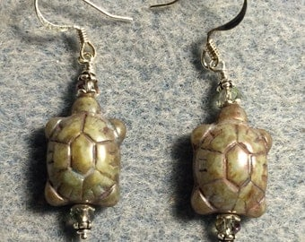 Green Picasso Czech glass turtle bead earrings adorned with green Chinese crystal beads.