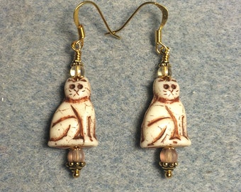 Tan and brown Czech glass cat bead dangle earrings adorned with tan Czech glass beads.