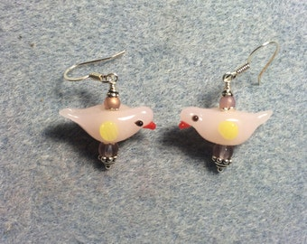 Light milky pink lampwork songbird earrings adorned with pink Czech glass beads.