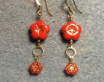 Bright red Czech glass puffy flower bead dangle earrings adorned with gold circle connectors and bright red Czech glass poppy beads.