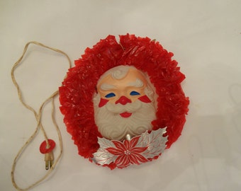 Red cellophane wreath with plastic Santa face vintage
