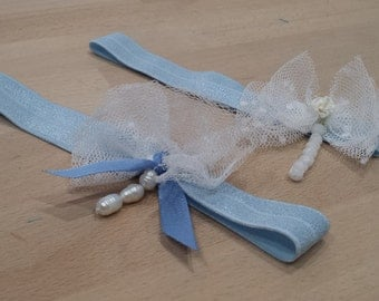Something blue... Garters in sky blue elastic, with bending of tulle and beads, 2 models to choose from.