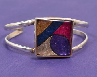 Silver Cuff Containing Geometric Shapes