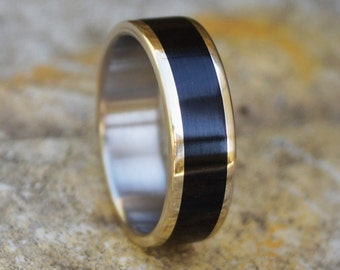 Titanium and brass ring with ebony wood inlay