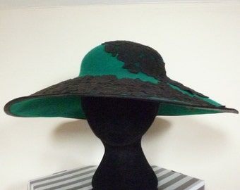 Stunning emerald green large brimmed hat with lace trim