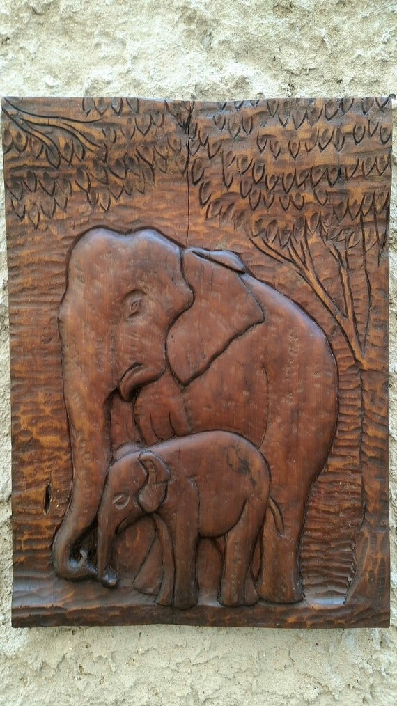 Hand carved african wood elephant wall paneling