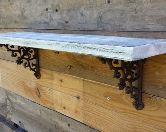 Rustic reclaimed wood / pallet shelf with cast iron brackets