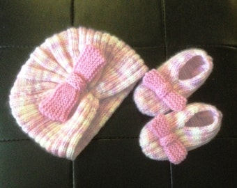 "Knitting pattern for ""Miss Abby"" hat and booties. Delightfully cute for any baby."