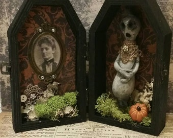 Little ghost in coffin