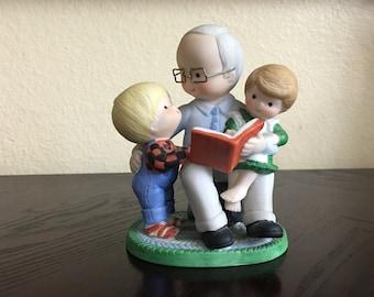 Enesco grandpa and children figure. Vintage. Reading grandpa