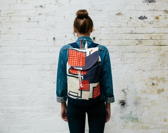 Rucksack Navy / Red Graphic Grid Print with Waxed Cotton Base & internal zip pocket