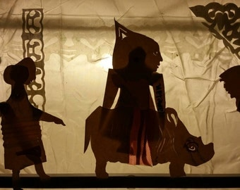 Shadow puppet scene with Rhino.  Giclée fine art print limited edition, from original ephemeral silhouette of papercut on glass